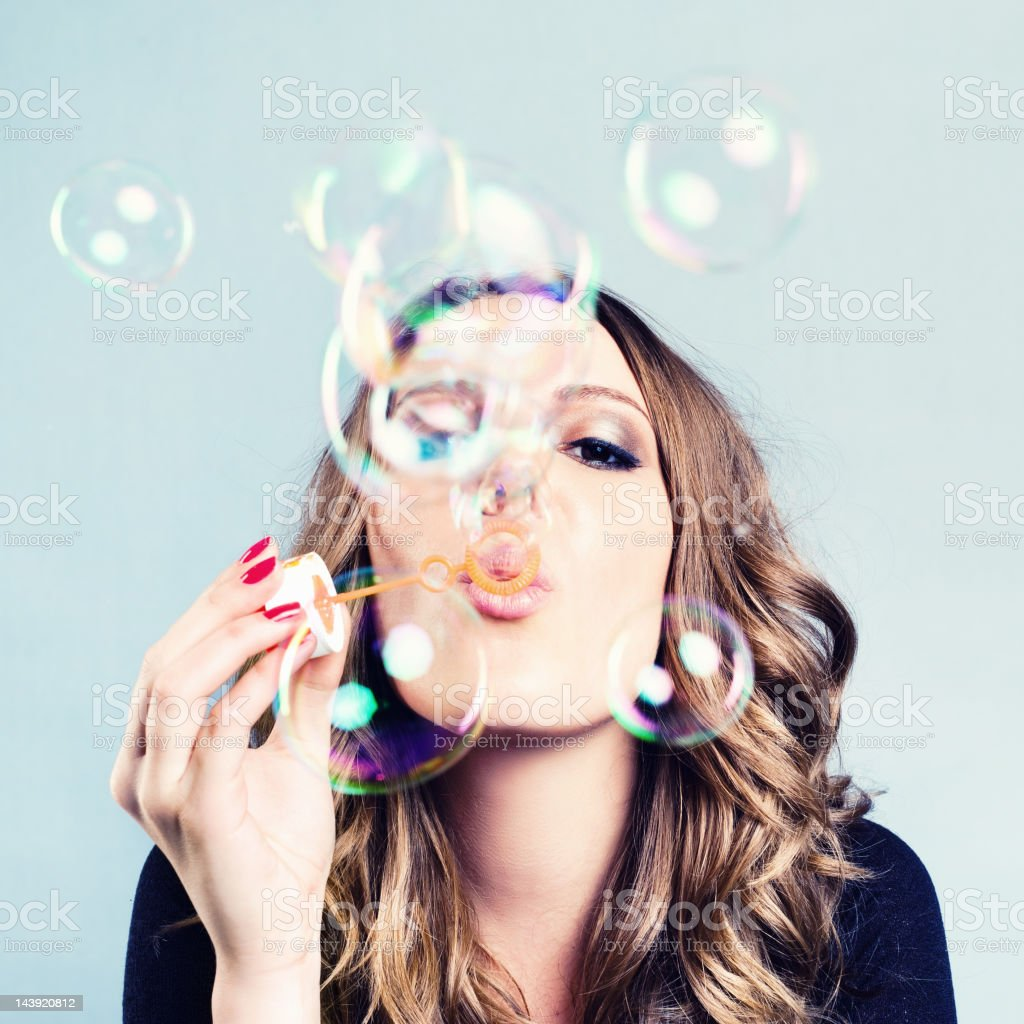 Woman Blow Bubbles stock photo