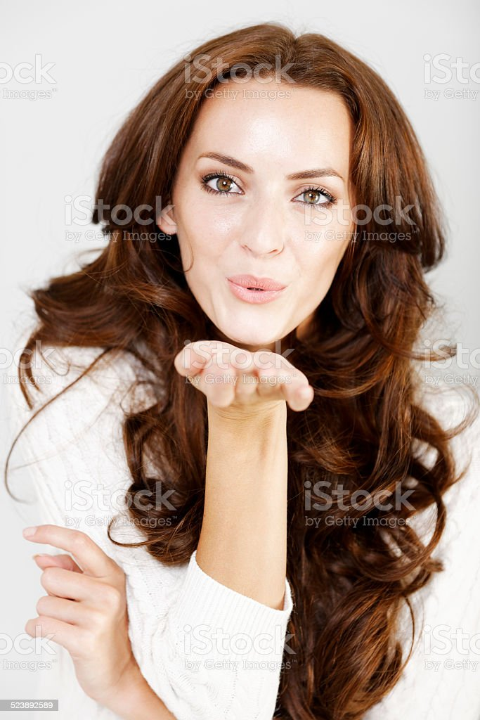 Woman blowing a kiss stock photo