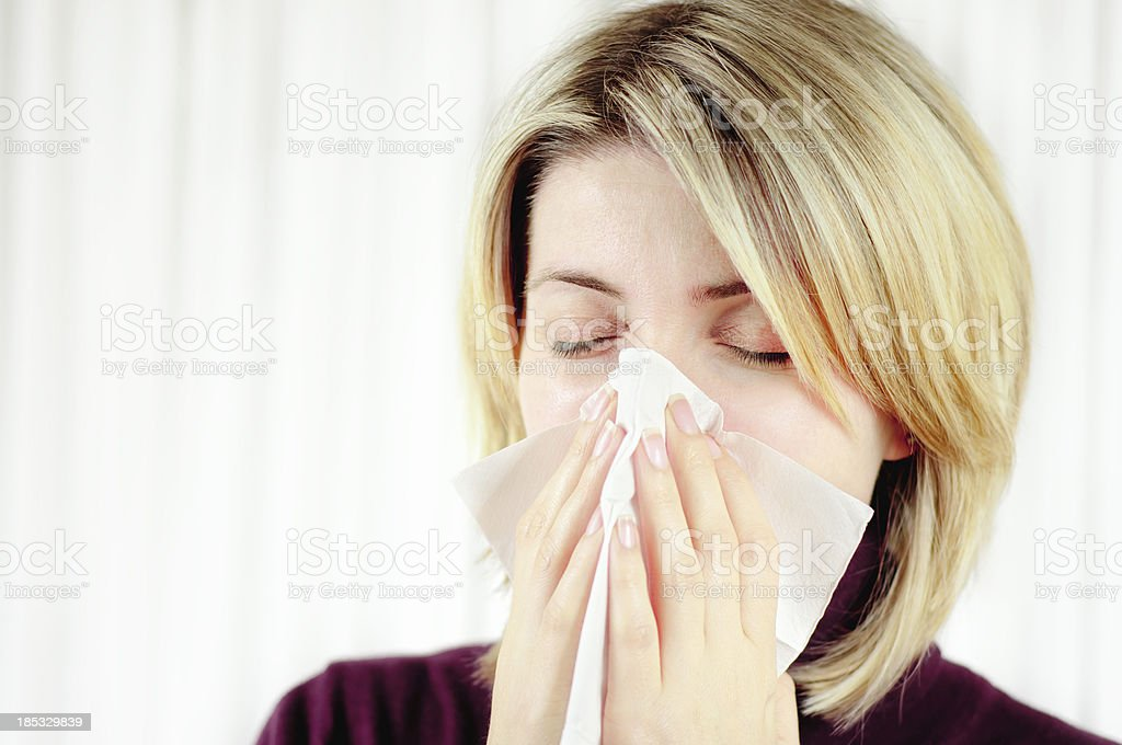 woman blowing her nose in handkerchief royalty-free stock photo