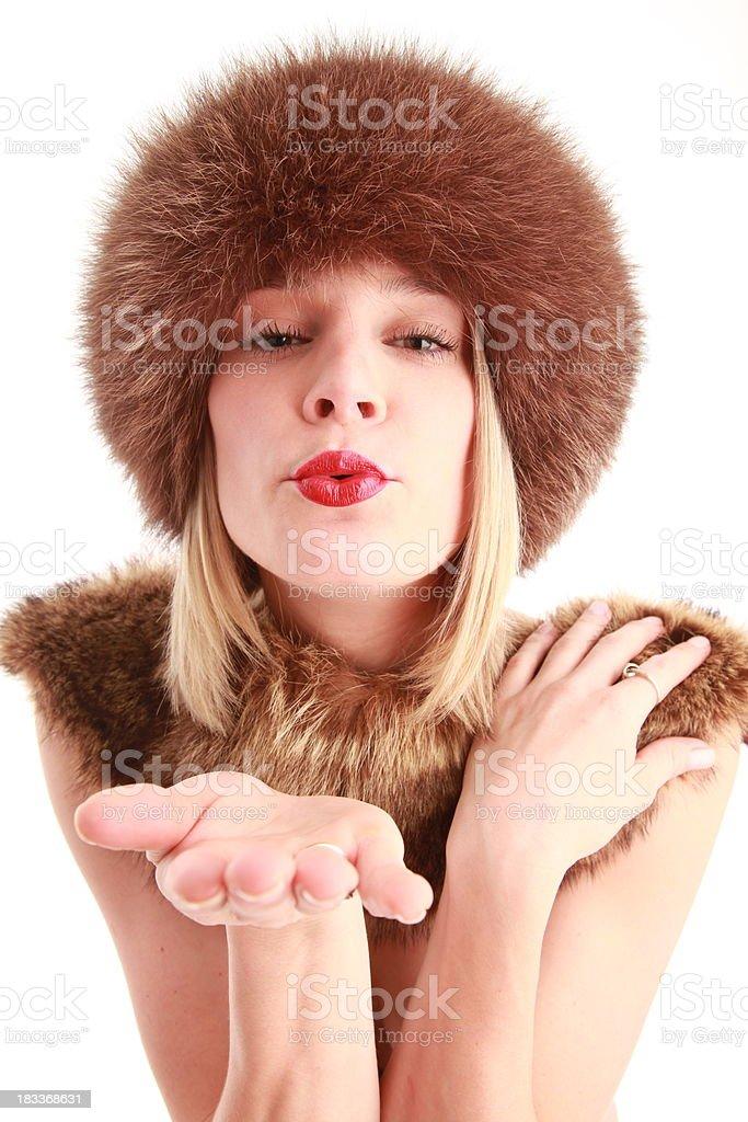 Mujer Soplando besos foto de stock libre de derechos