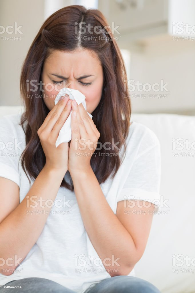 Woman blowing nose stock photo