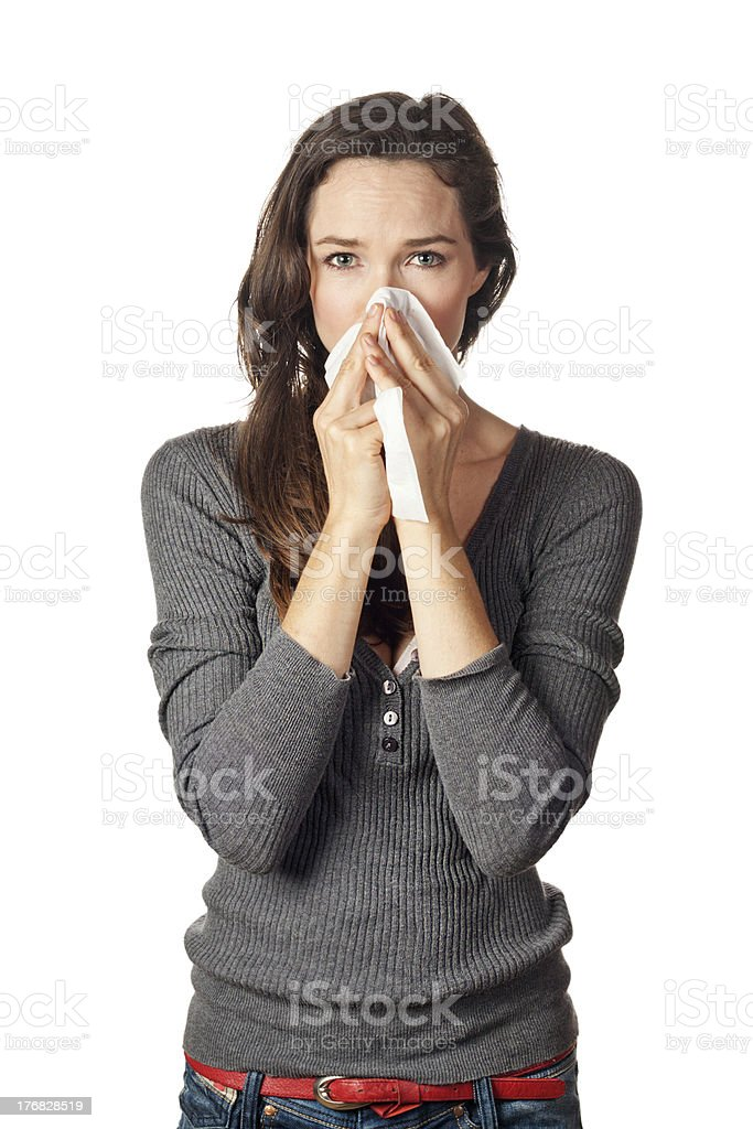 Woman  blowing or wiping her nose royalty-free stock photo