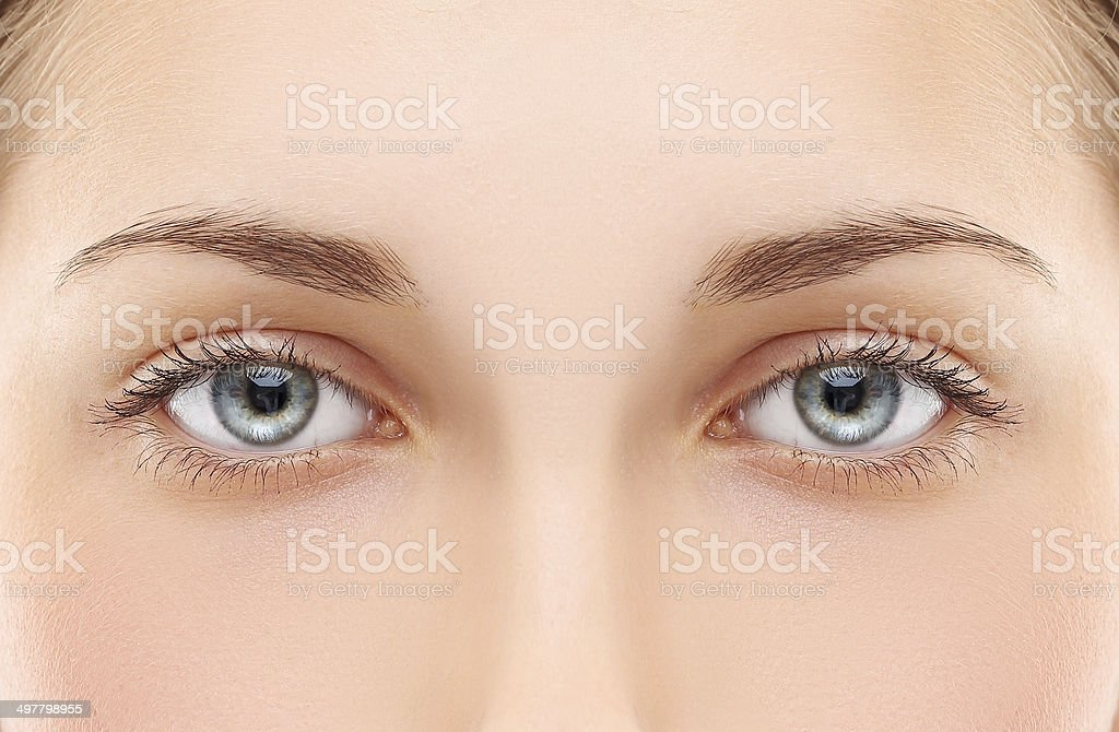 Woman blue eye stock photo