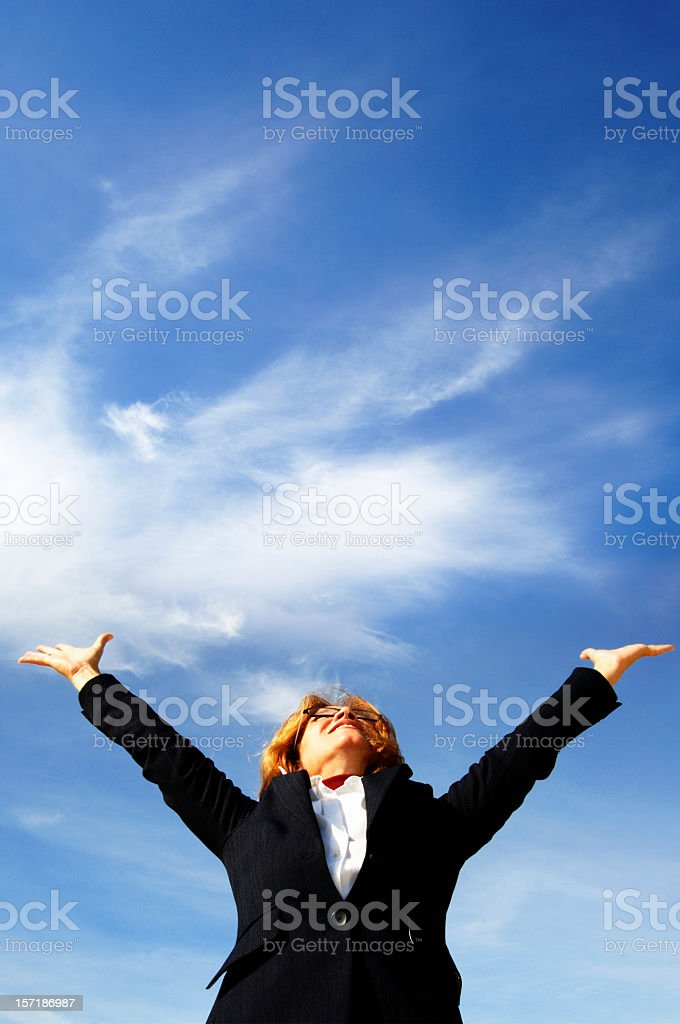 Woman blue sky, with some white clouds. royalty-free stock photo