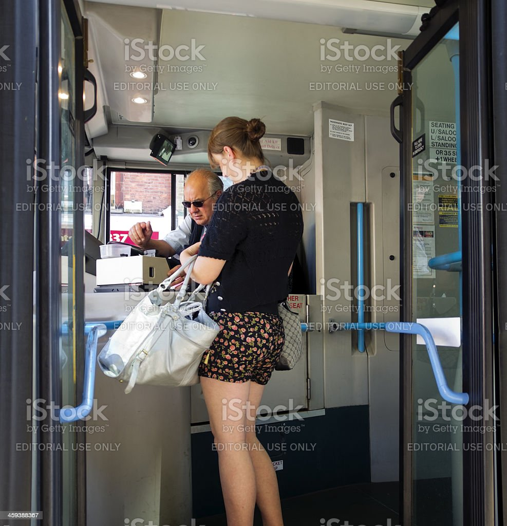 Woman boarding a bus royalty-free stock photo