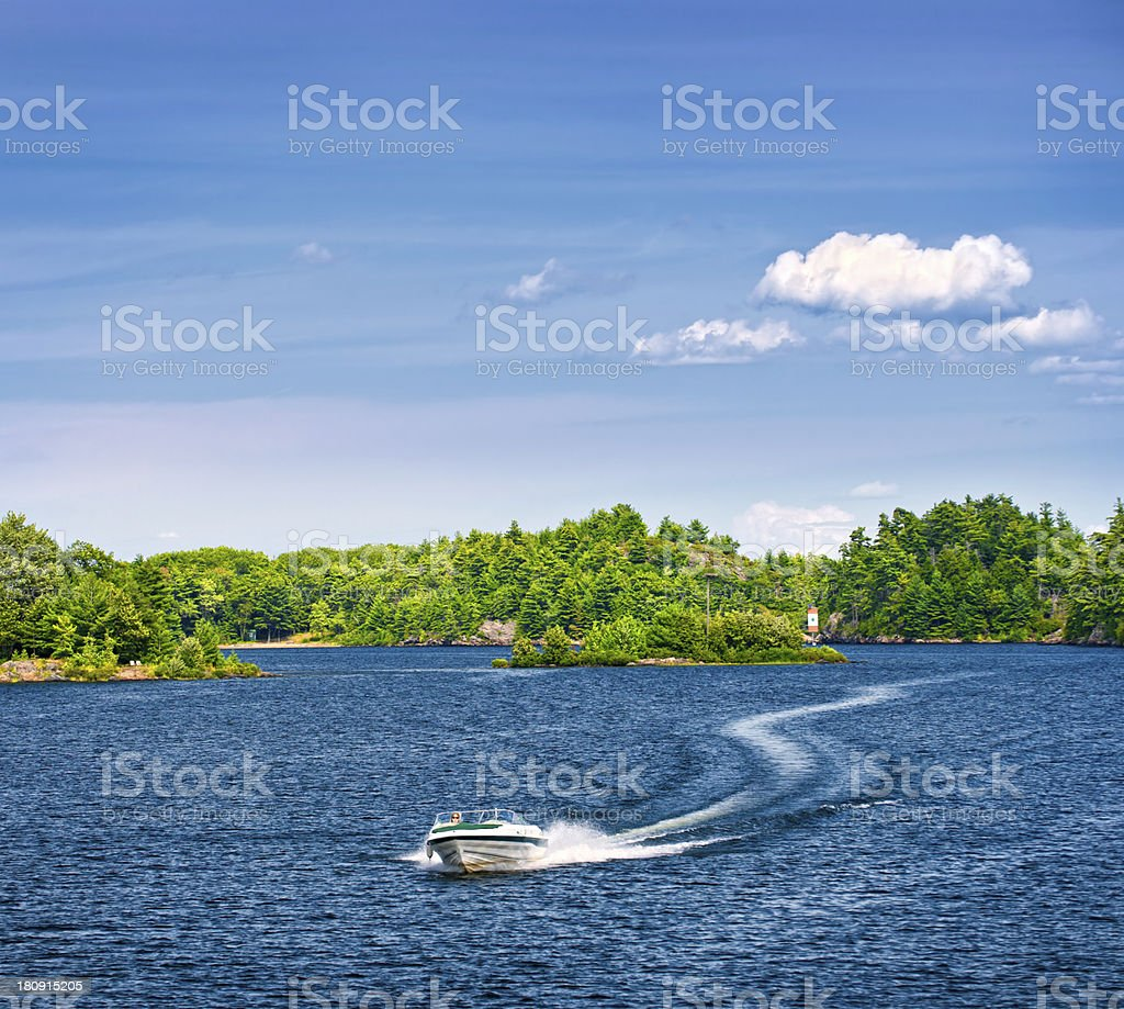 Woman boating on lake stock photo