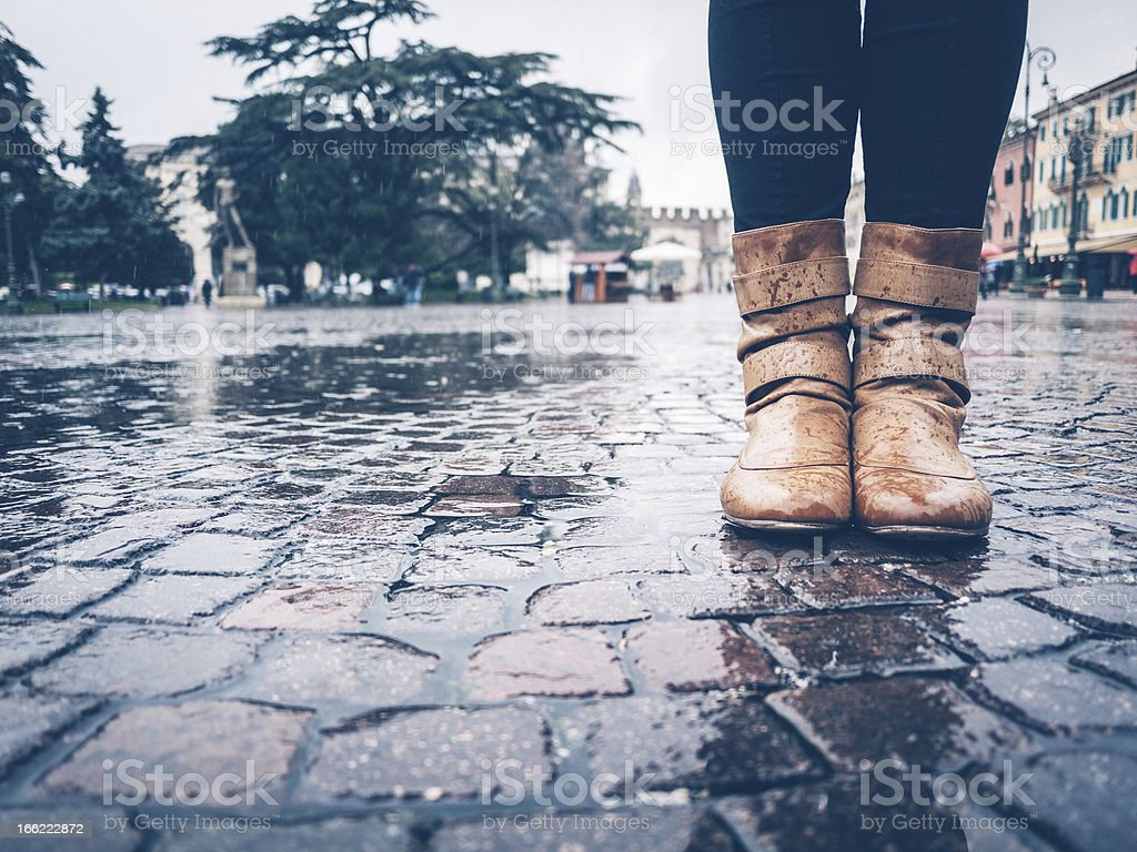 Woman Boots under the Rain in Europe stock photo