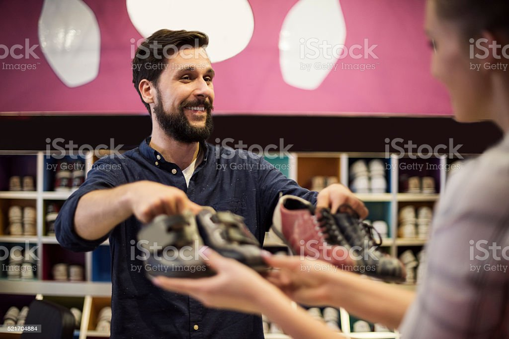 Woman borrowing some shoes for bowling stock photo