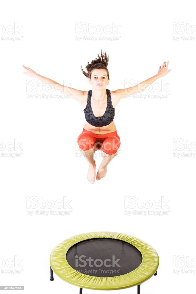 Woman bouncing  on trampoline stock photo