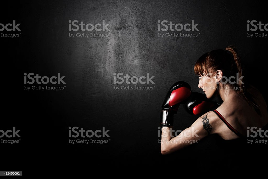 Woman Boxer with Red Gloves on Black Backgroung stock photo