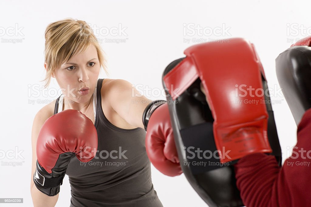 Woman boxing and exercising royalty-free stock photo