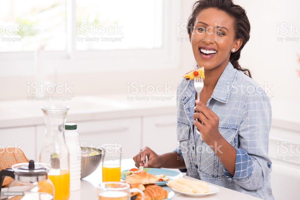 Woman breakfast at kitchen. stock photo