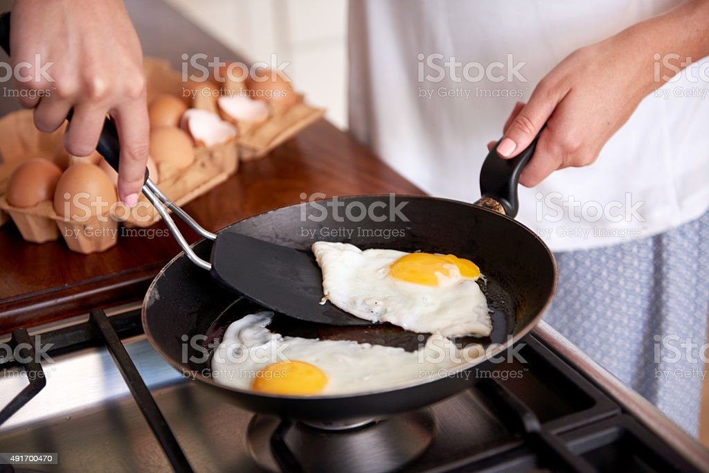 woman breakfast eggs stock photo