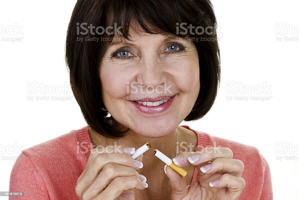 Woman breaking a cigarette royalty-free stock photo