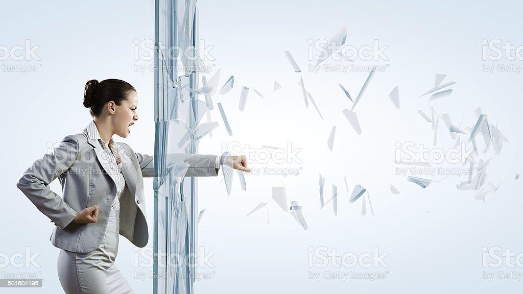 Woman breaking glass stock photo