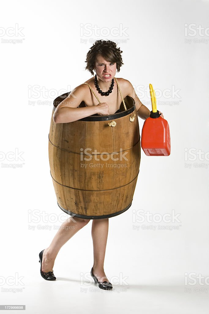woman broke in barrel from high gas prices royalty-free stock photo