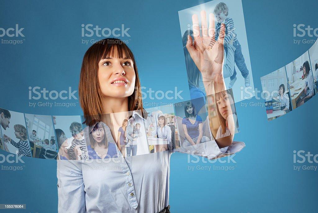 Woman browsing a futuristic photo library stock photo