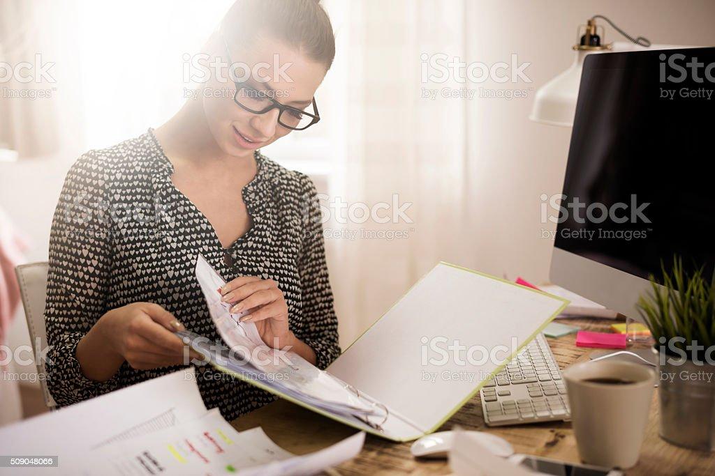 Woman browsing a ring binder stock photo