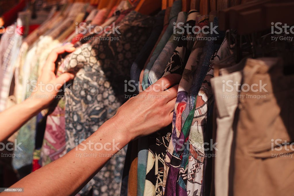 Woman browsing clothes at market stock photo