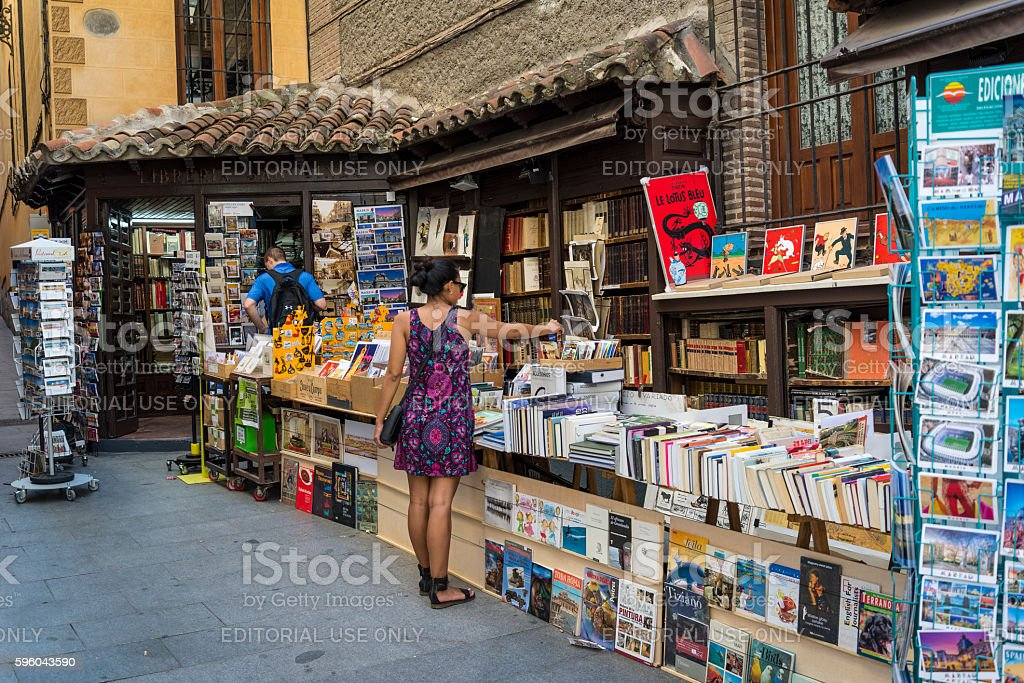 Woman browsing in secondhand bookshop, Madrid, Spain stock photo