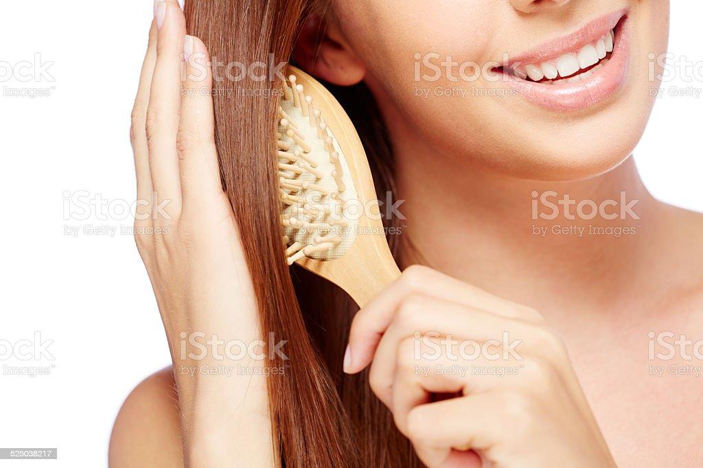 Woman brushing hair stock photo