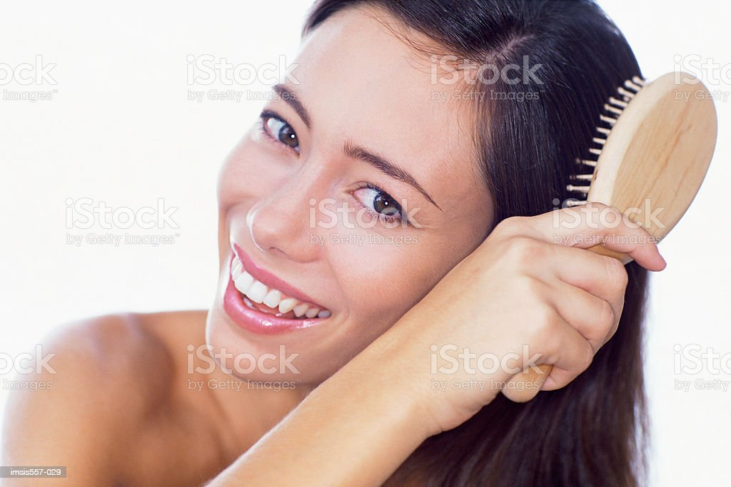 Woman brushing hair royalty-free stock photo