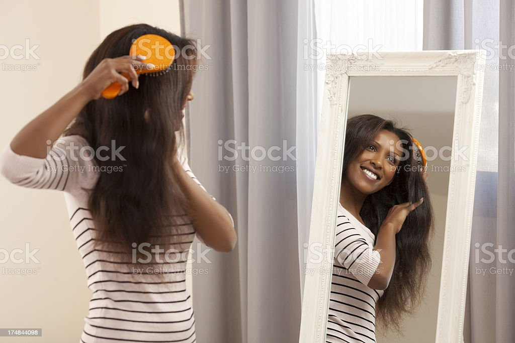 Woman brushing her hair. royalty-free stock photo