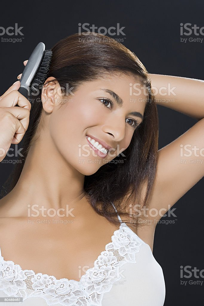 A woman brushing her hair royalty-free stock photo