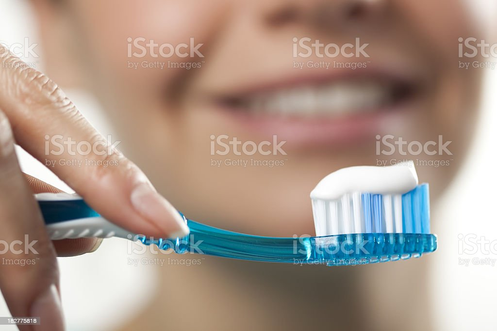 Woman brushing teeth stock photo