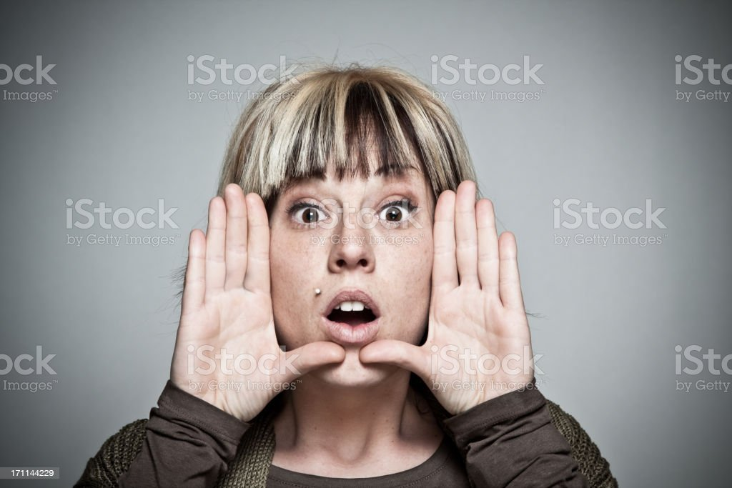 Woman building frame with the hands around her face royalty-free stock photo