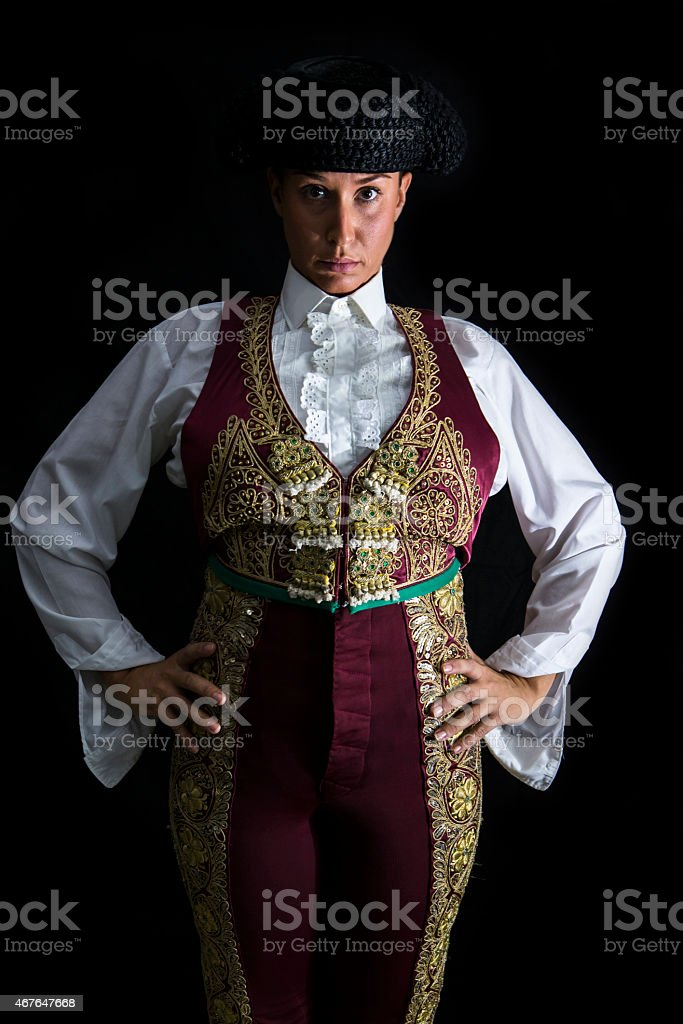 Woman bullfighter by dressing in a costume of old lighting stock photo