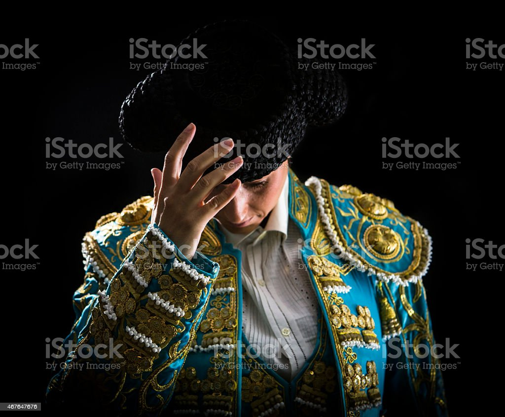 Woman bullfighter salutes with his montera in stock photo