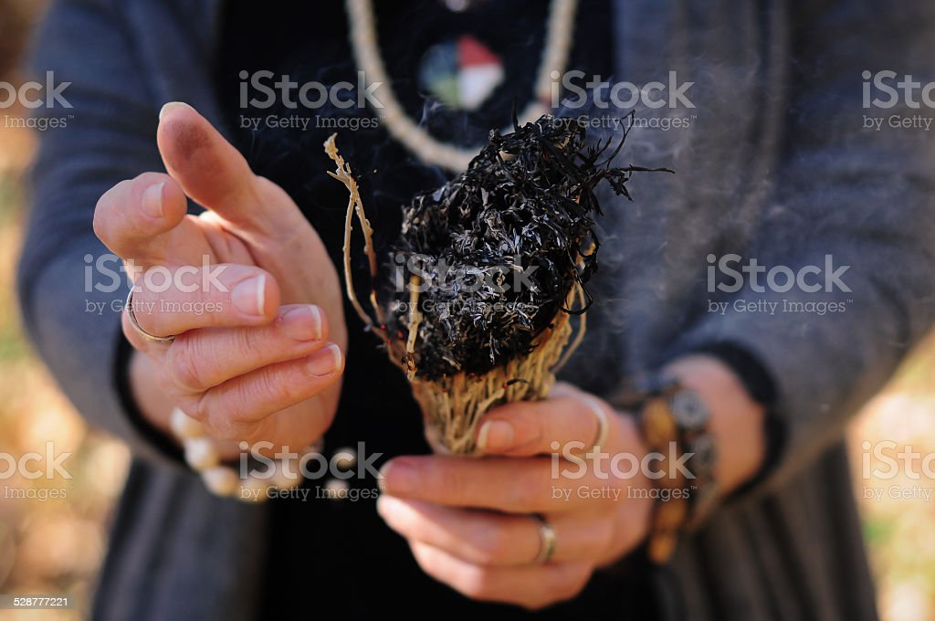 Woman burning sage stock photo