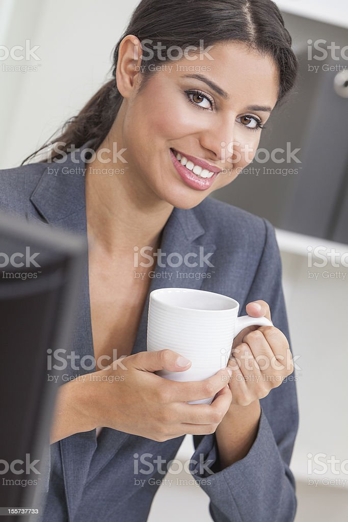 Woman Businesswoman Drinking Coffee in Office royalty-free stock photo