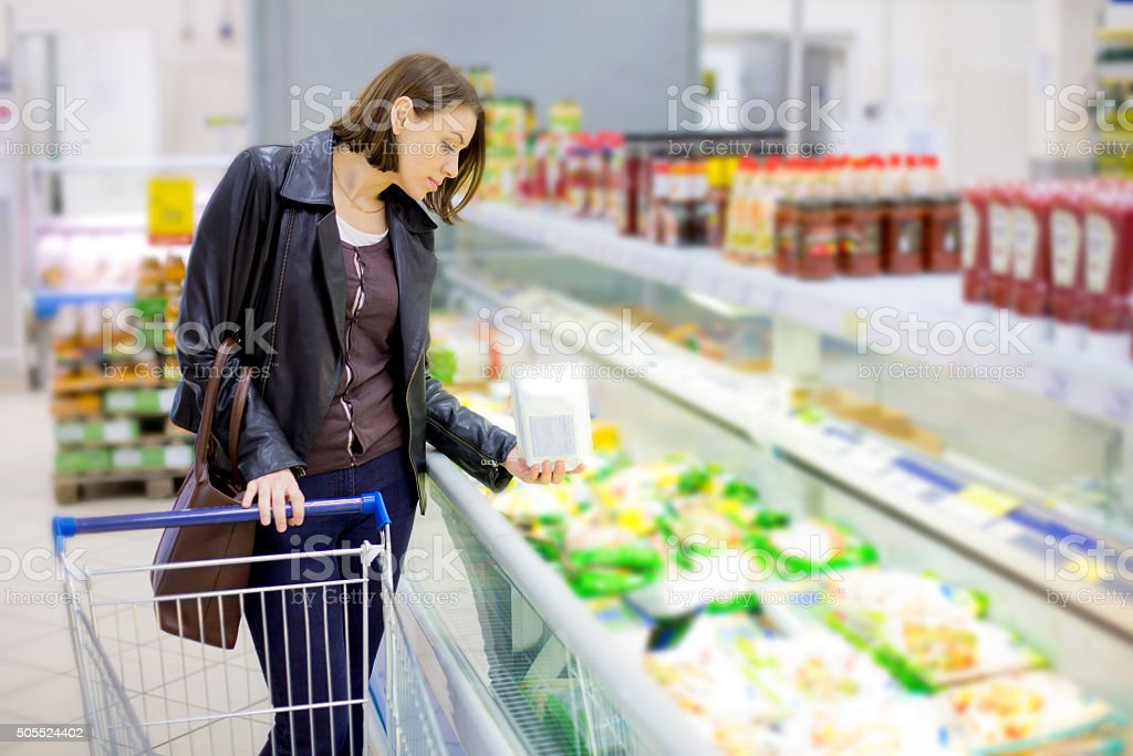woman buy frozen fish in the supermarket stock photo
