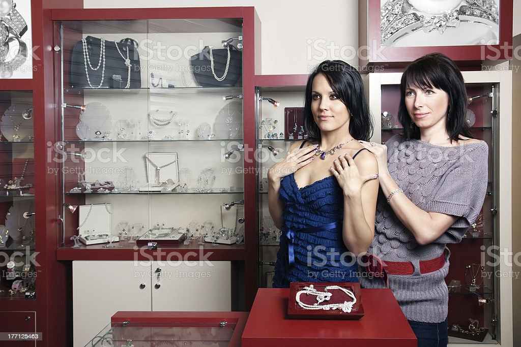 woman buyer being served by sales assistant royalty-free stock photo