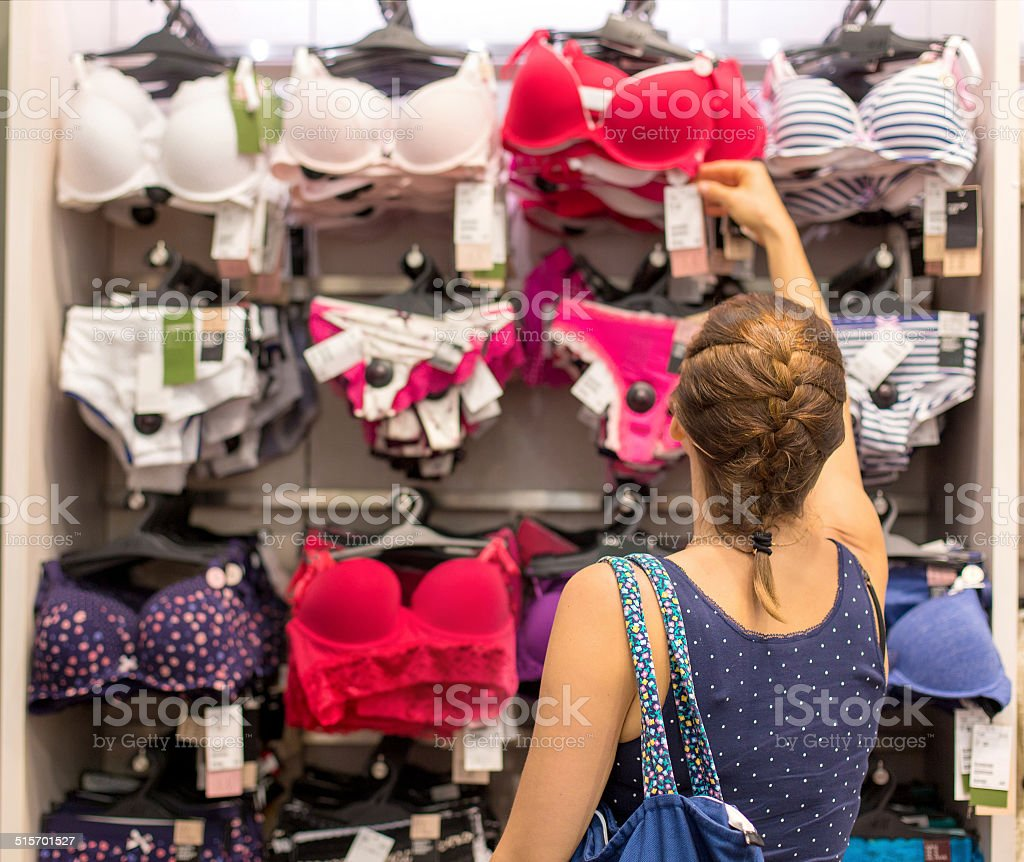 woman buying a bra stock photo