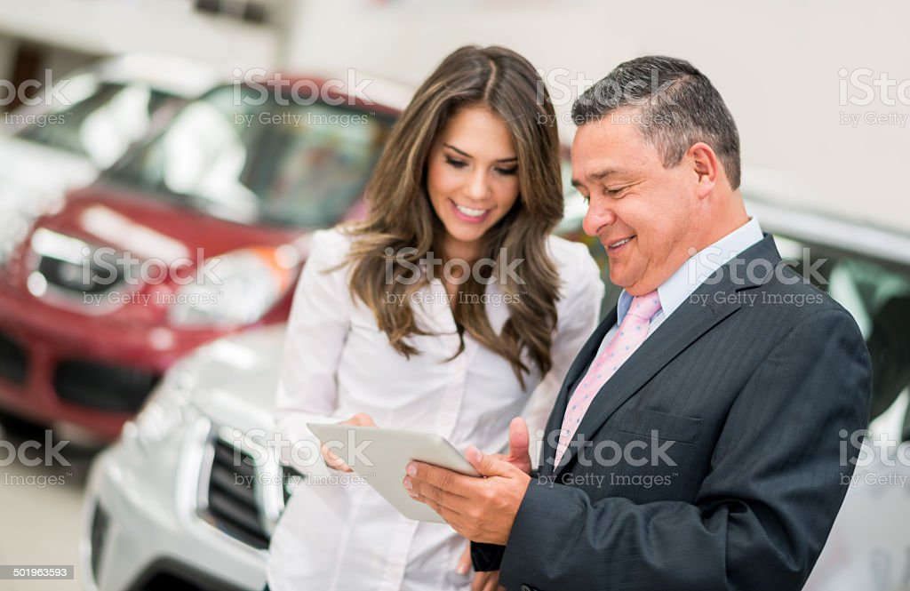 Woman buying a car stock photo