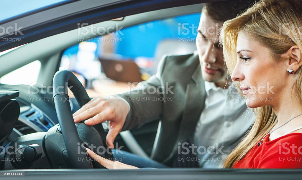 Woman buying a car. stock photo