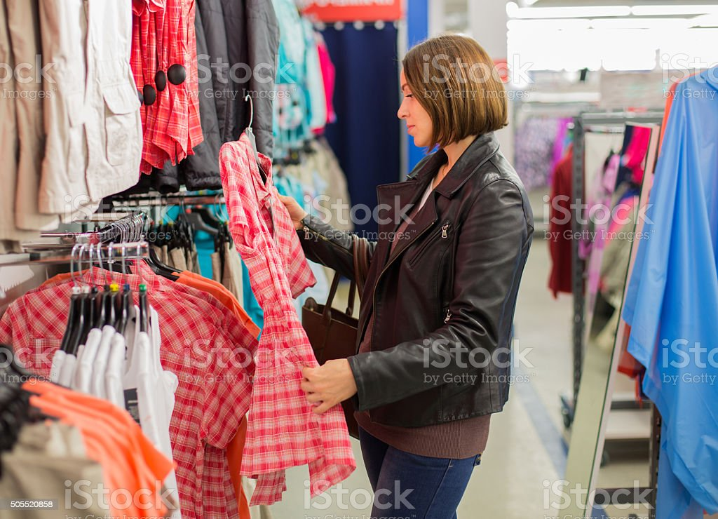 woman buying a dress at a boutique stock photo