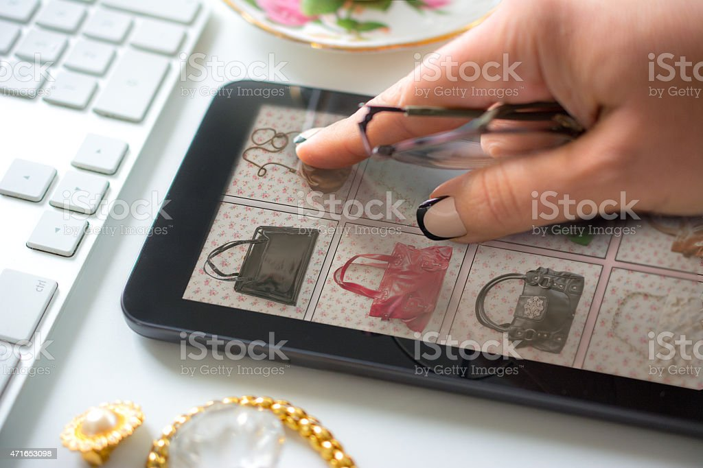 Woman buying a vintage handbag online stock photo