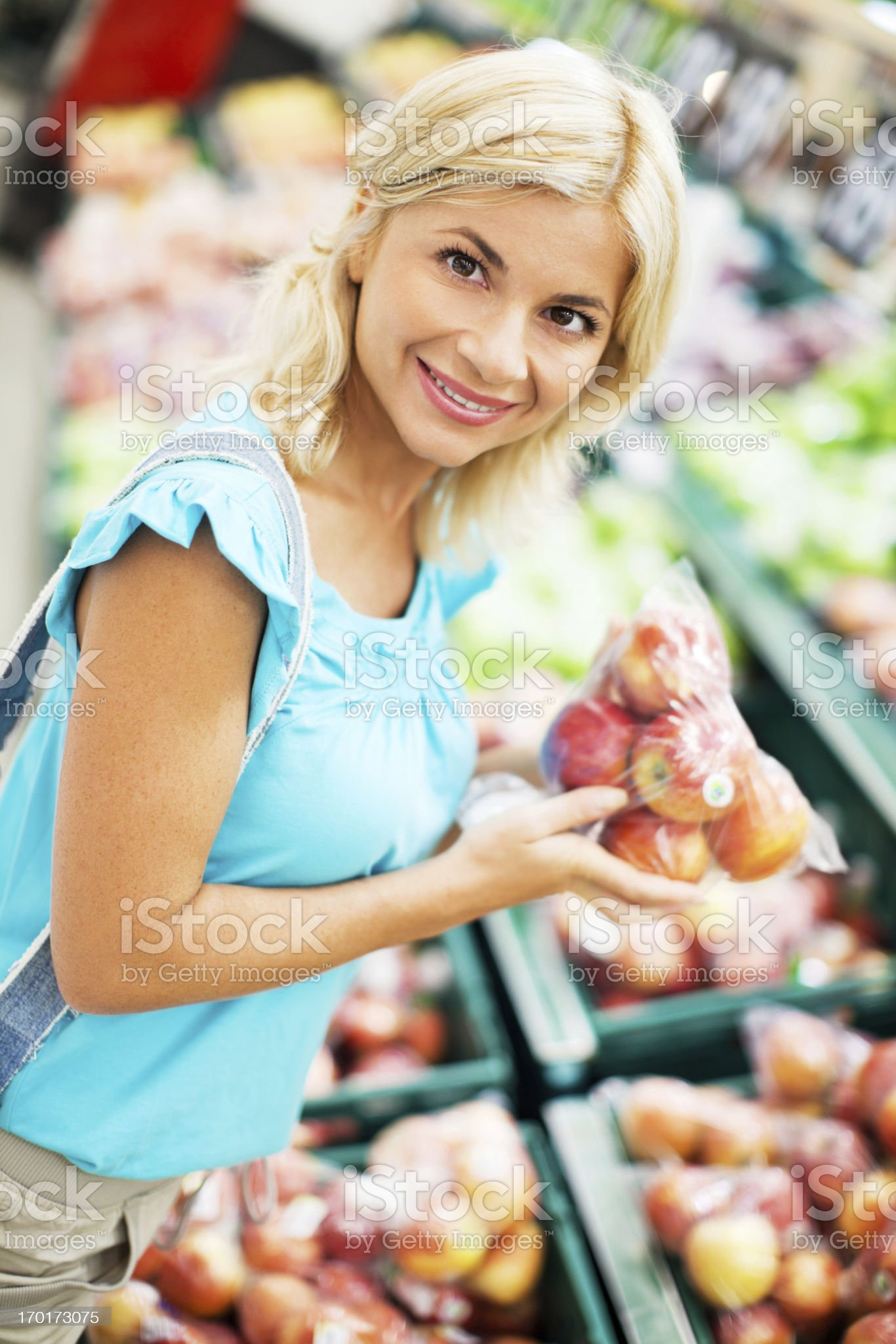 Woman buying apples in the fruit store royalty-free stock photo
