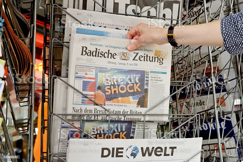 Woman buying Badische Zeitung about Brexit stock photo