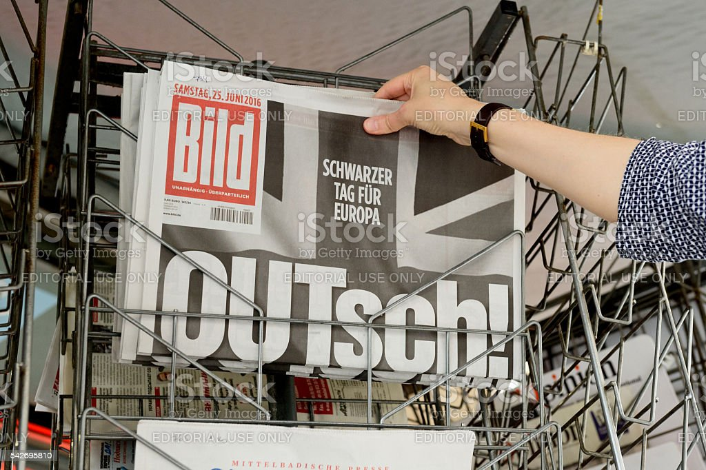 Woman buying Bild Germany newspaper about Brexit stock photo