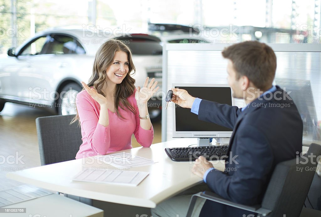 Woman buying car. stock photo