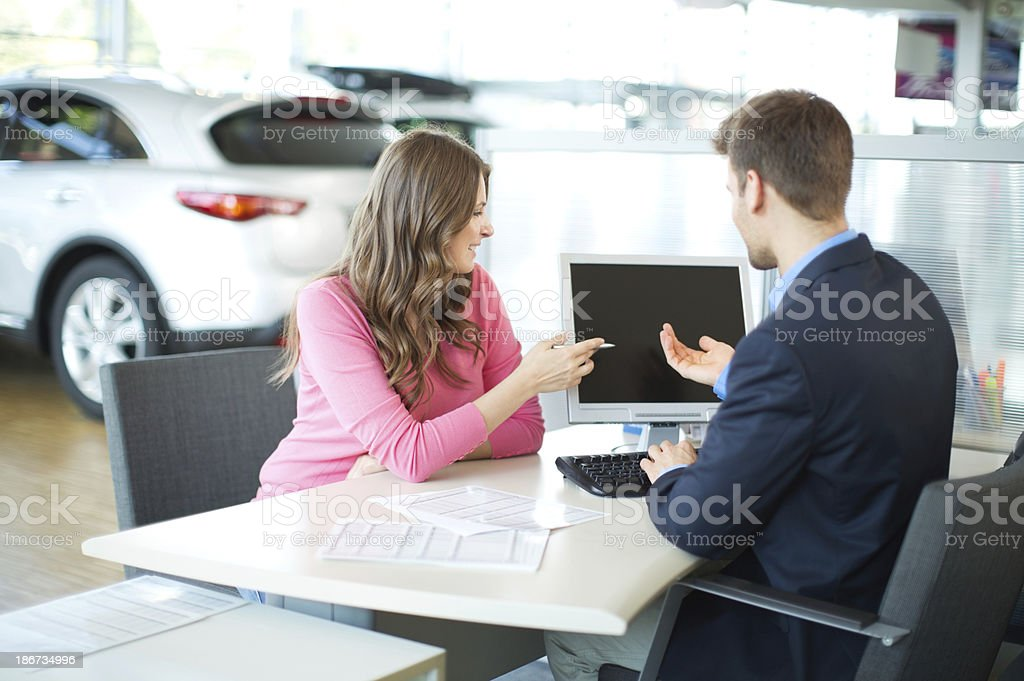 Woman buying car. royalty-free stock photo