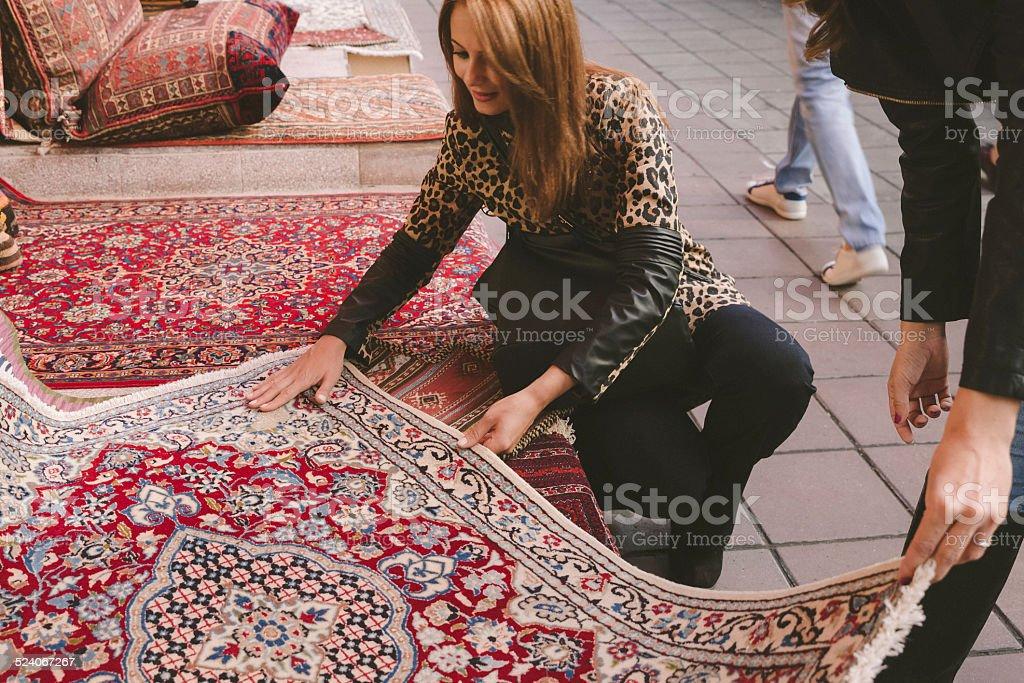 Woman Buying Carpets stock photo