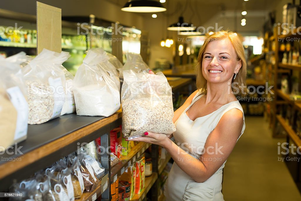 woman buying cereals in grocery store stock photo