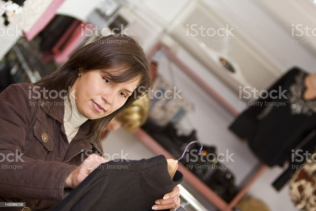 Woman buying clothes royalty-free stock photo