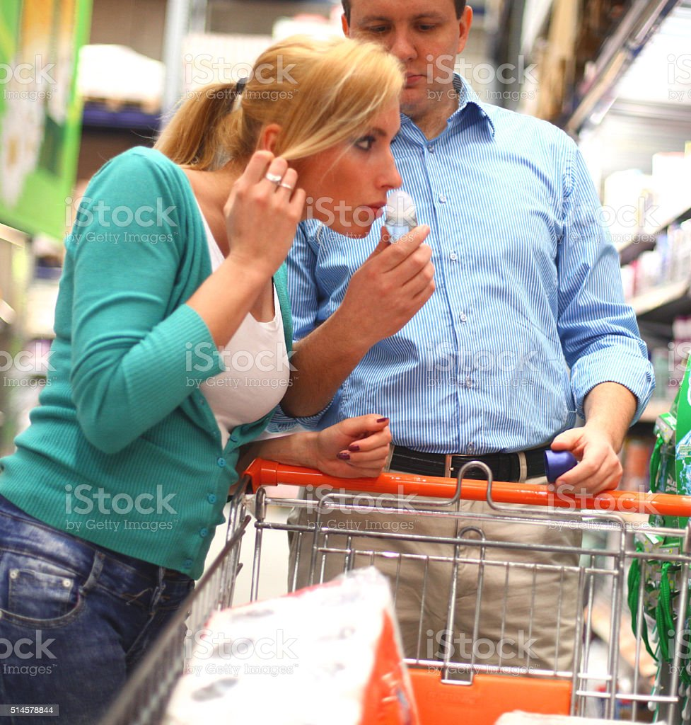 Woman buying cosmetics in supermarket stock photo